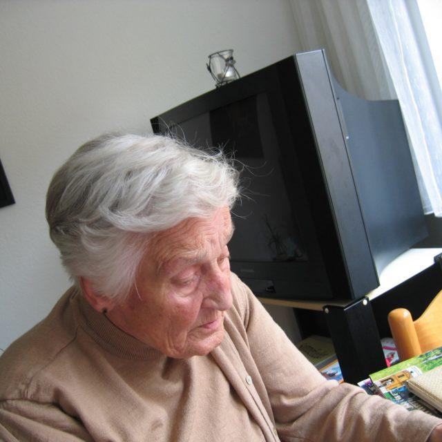 Senior Woman Considering Downsizing Tampa FL Movers